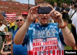 A supporter of Republican presidential candidate Donald Trump takes a picture at a pro-Trump rally near the Republican National Convention in Cleveland, Ohio. (Reuters)
