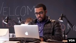 A former Harvard Business School student works on a project in the Manhattan offices of the HBS StartUp Studio