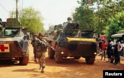 FILE - A French soldier patrols the northern district of Bangui in the Central African Republic in December 2013.
