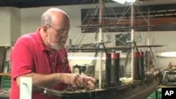 Conservator Colan Ratliff has spent 24 years working on this model of a US Navy ship.