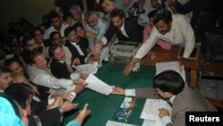 Pakistan's former prime minister Nawaz Sharif (C) submits his nomination papers for the upcoming by-elections in Lahore May 13, 2008. Pakistani prime minister Yousuf Raza Gilani called for a last-ditch effort to save his government on Tuesday, after refus