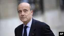 New French Defense Minister Alain Juppe arrives for the first weekly meeting of a reshuffled French government, Paris, 17 November 2010