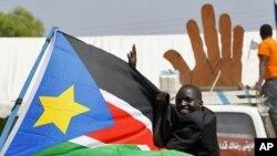 Wani dan kasar Sudan yana nuna goyon bayan ballewa a Juba, 07 ga Janairu, 2011.