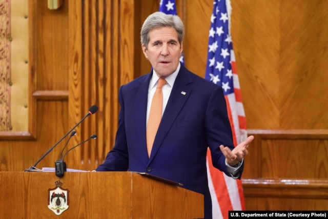 U.S. Secretary of State John Kerry addresses reporters during a joint news conference with Jordanian Foreign Minister Nasser Judeh, not shown, following a bilateral meeting in Amman, Feb. 21, 2016.