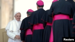 Pope Francis is greeted by bishops during his general audience in St Peter's Square at the Vatican, May 8, 2013.
