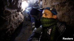 A Palestinian works inside a smuggling tunnel beneath the Egyptian-Gaza border, Feb. 19, 2013
