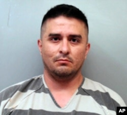 FILE - This file photo provided by the Webb County Sheriff's Office shows Juan David Ortiz, a U.S. Border Patrol supervisor who was jailed Sept. 16, 2018, on a $2.5 million bond in Texas, accused in the killing of at least four women.