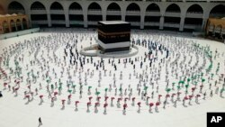 Hundreds of Muslim pilgrims circle the Kaaba as they keep social distance to protect themselves against the coronavirus ahead of the Hajj pilgrimage in the Muslim holy city of Mecca, Saudi Arabia, July 29, 2020. (AP Photo)