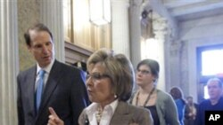 Sen. Barbara Boxer, D-Calif., right, and Sen. Ron Wyden, D-Ore., left, arrive to vote on the spending bill in the Senate at the Capitol in Washington, Wednesday, March 9, 2011.