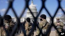 Pasukan Garda Nasional AS mengamankan gedung Capitol di Washington DC Kamis (4/3).