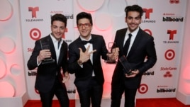 Singers Gianluca Ginoble, left, Piero Barone and Ignazio Boschetto of the group Il Volo, show their awards at the Latin Billboard Awards, April 24, 2014, in Coral Gables, Fla.