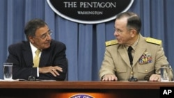 Defense Secretary Leon Panetta, left, and Joint Chiefs Chairman, Adm. Mike Mullen, brief the media at the Pentagon in Washington, on Sept. 20, 2011.