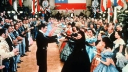 """Clark Gable and Vivien Leigh play Rhett Butler and Scarlett O'Hara, center, in the 1939 movie """"Gone With the Wind"""""""
