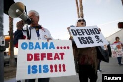 FILE - Raul Rodriguez Jr., left, of America First Latinos protests against the Islamic State group ahead of President Barack Obama's visit with the families of shooting victims in San Bernardino, California, Dec. 18, 2015.