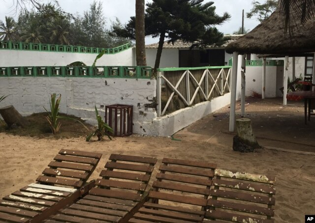FILE - Bullet holes are seen on a wall, center, outside of the Nouvelle Paillote hotel, one of the three hotels involved in an attack at Grand Bassam, Ivory Coast, March 14, 2016.