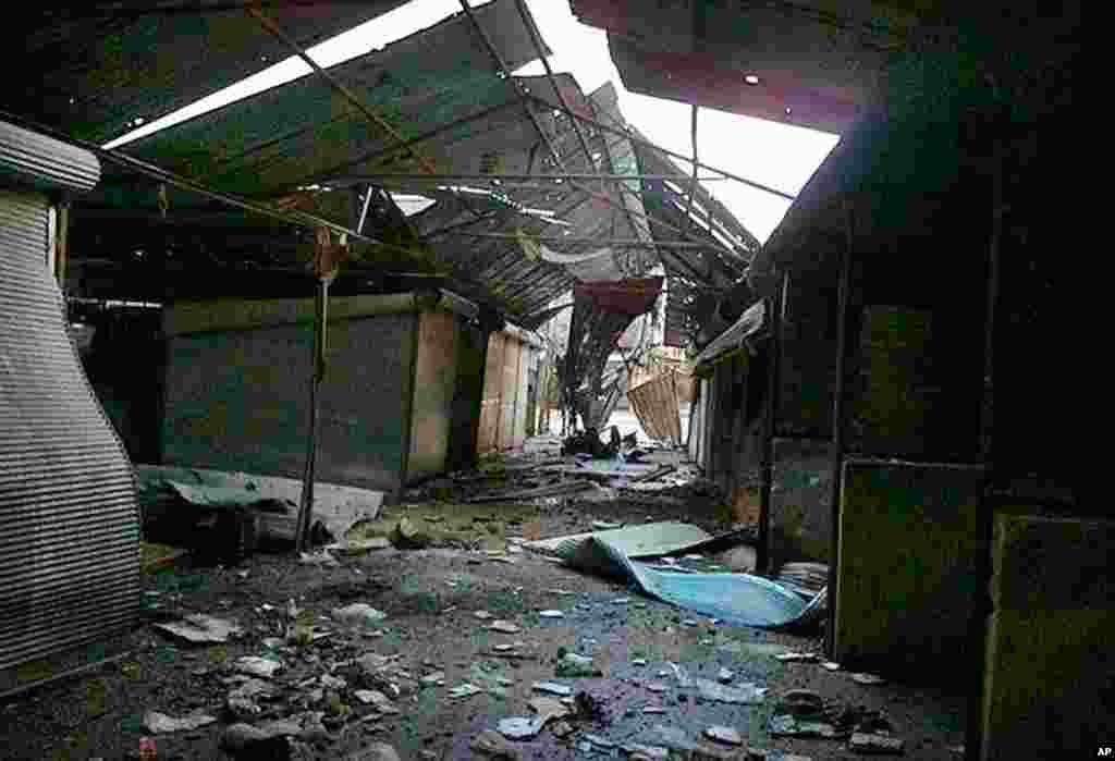 A market destroyed from Syrian government forces shelling, at the Baba Amr neighborhood in Homs province, February 20, 2012 (AP/Local Coordination Committees in Syria)
