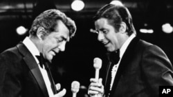 Dean Martin, left, and Jerry Lewis, whose comedy team broke up more than 20 years ago, appear together for the first time since the breakup on Lewis annual telethon for Muscular Dystrophy, Sept. 7, 1976, Las Vegas, Nevada.