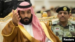 Saudi Crown Prince Mohammed bin Salman gestures during a military parade by Saudi security forces in preparation for the annual Haj pilgrimage in the holy city of Mecca, Saudi Arabia, Aug. 23, 2017. Saudi Arabia called off talks with Qatar shortly after reports it had agreed to talks.
