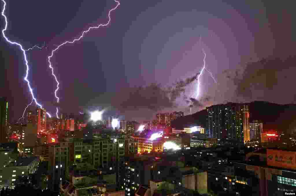 Lightning flashes in the sky in Zhuhai, Guangdong province, China, May 22, 2013.