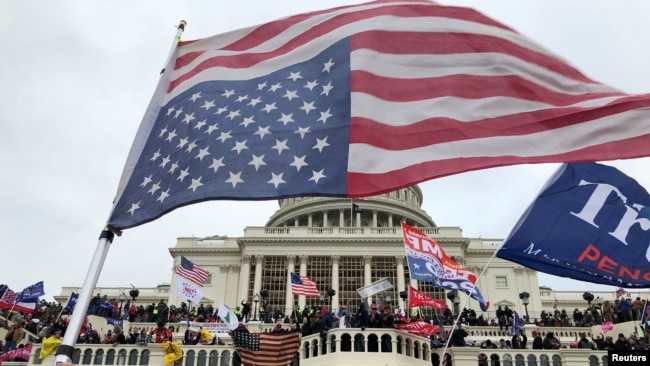 Supporters of U.S. President Donald Trump occupy the U.S. Capitol Building in Washington, U.S., January 6, 2021. Thomas P. Costello/USA TODAY via REUTERS NO RESALES. NO ARCHIVES