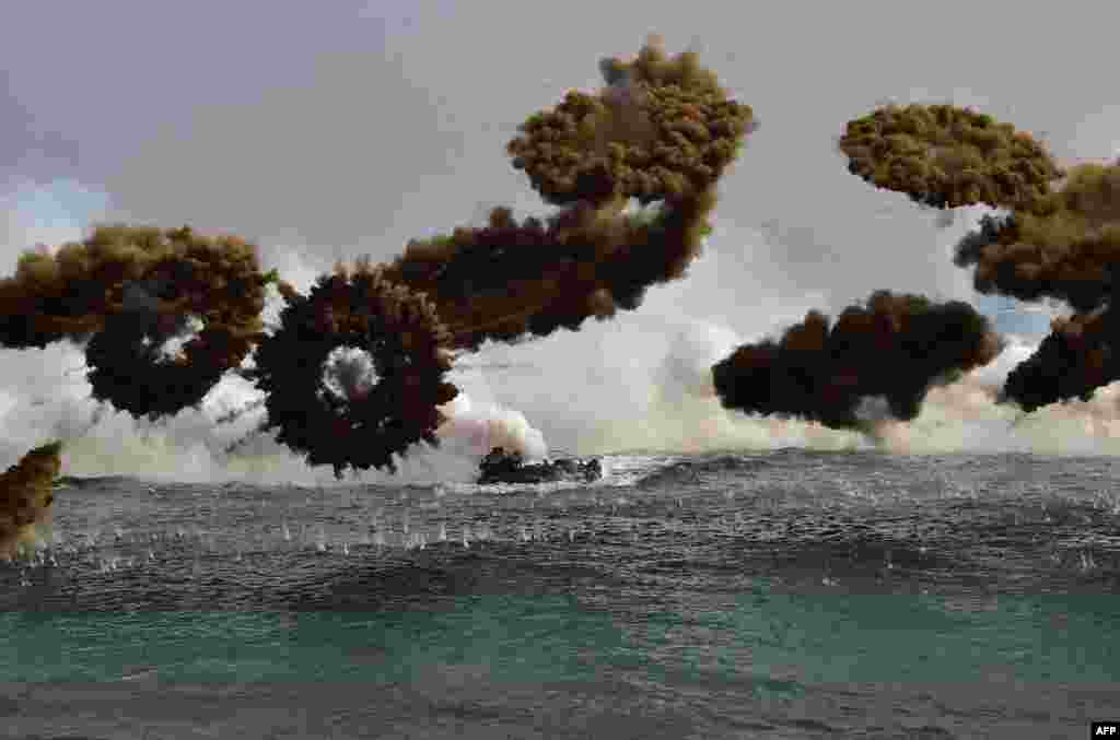 South Korean Marine vehicles fire smoke shells before a landing during a joint operation by U.S. and South Korean Marines in the southeastern port of Pohang.