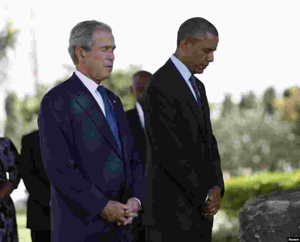 U.S. President Barack Obama and former president George W. Bush (left) attend a memorial for the victims of the 1998 U.S. embassy bombing in Dar es Salaam, July 2, 2013.