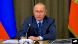 FILE - Russian President Vladimir Putin heads a meeting with senior military officials at the Black Sea resort of Sochi, Russia, Nov. 16, 2016.