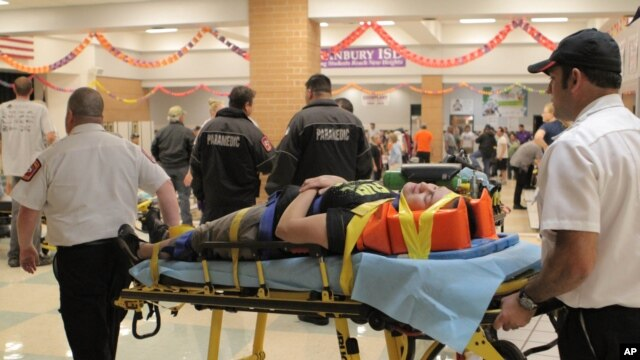 An unidentified injured person is carried to an ambulance in Granbury, Texas, May 15, 2013.