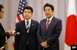 Japanese Prime Minister Shinzo Abe, right, speaks to members of the press after meeting with President-elect Donald Trump, Nov. 17, 2016.