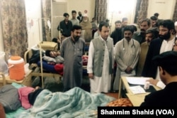 Khyber Pakhtunkhwa Minister for Education Muhammad Atif Khan inquires about injured patients at the DHQ hospital in Mardan, Pakistan, Oct. 27, 2015.