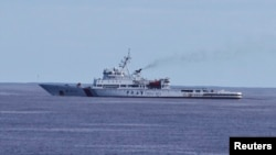 Kapal patroli China Haixun 01 melakukan pencarian pesawat Malaysia Airlines di Samudera Hindia (5/4).