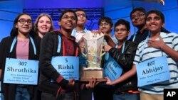 Co-champions of the 2019 Scripps National Spelling Bee, from left, Shruthika Padhy, Erin Howard, Rishik Gandhasri, Christopher Serrao, Saketh Sundar, Sohum Sukhatankar, Rohan Raja and Abhijay Kodali hold the trophy in Oxon Hill, Md., May 31, 2019.