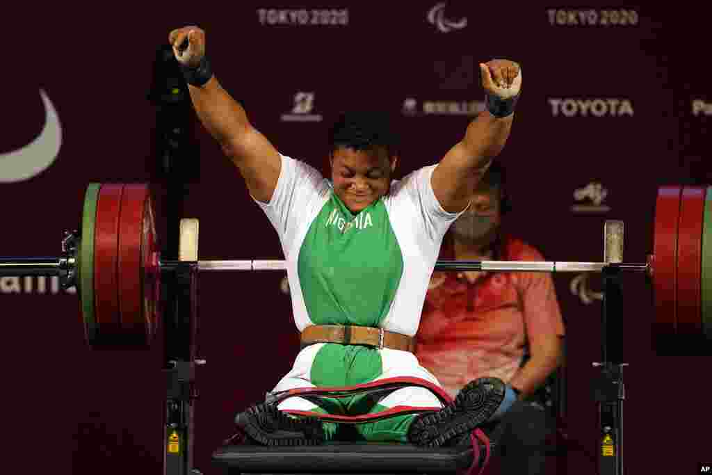 Nigeria's Folashade Oluwafemiato celebrates after winning a gold medal in women's -86kg powerlifting final at the Tokyo 2020 Paralympic Games, in Tokyo, Japan. (AP Photo/Kiichiro Sato)