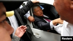 Mexico's President-elect Andres Manuel Lopez Obrador gestures as he leaves a meeting with the new members the Senate and lawmakers of his party MORENA in Mexico City, July 11, 2018.