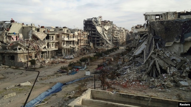 Damaged buildings and debris are pictured in the besieged area of Homs, Syria, Dec. 24, 2013.