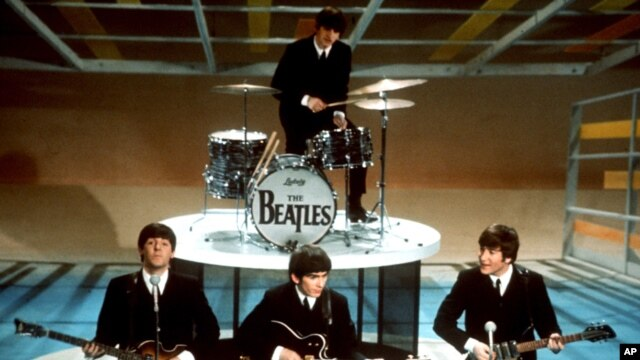 """FILE - In this Feb. 9, 1964 file photo, The Beatles perform on the CBS """"Ed Sullivan Show"""" in New York. An acetate record cut by the Beatles before the Liverpool band hit stardom is going on auction."""