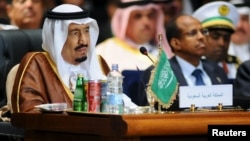 FILE - Saudi King Salman attends the opening meeting of the Arab Summit in Sharm el-Sheikh, in the South Sinai governorate, south of Cairo, March 2015.