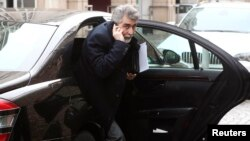 Iran's ambassador to Austria Hassan Tajik leaves his limousine as he arrives at a hotel in Vienna, Feb. 17, 2014.