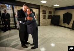 This Monday, April 3, 2017 file photo shows civil rights activist Jesse Jackson and former UN Ambassador Andrew Young embracing during a ceremony at the Memphis International Airport to unveil a historic marker commemorating the final flight of Dr. King.