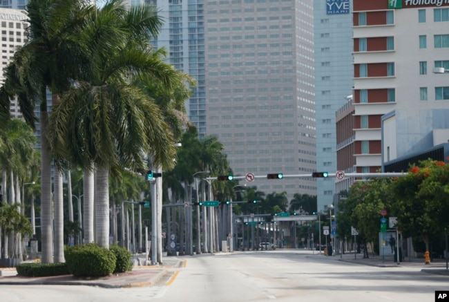 A street usually filled with cars is seen in deserted downtown Miami, Florida, Sept. 8, 2017. State authorities have asked 5.6 million people - more than one-quarter of Florida's population - to evacuate.