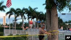 Police tape off an area by the Trump National Doral resort after reports of a shooting inside the resort, May 18, 2018 in Doral, Fla.