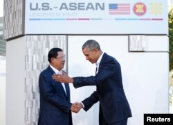 FILE - U.S. President Barack Obama welcomes Cambodia's Prime Minister Hun Sen upon his arrival at Sunnylands for a 10-nation Association of Southeast Asian Nations (ASEAN) summit in Rancho Mirage, California February 15, 2016.