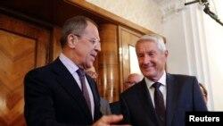 Menteri Luar Negeri Rusia Sergei Lavrov (kiri) bersama Sekjen OSCE Thorbjorn Jagland di Moskow (4/9).