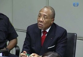 Former Liberian President Charles Taylor appearing in court at the Special Court for Sierra Leone in Leidschendam, Jan. 22, 2013.