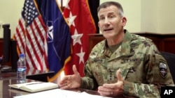 FILE - Head of NATO and U.S. forces in Afghanistan, U.S. Army Gen. John W. Nicholson, is interviewed in Kabul, Afghanistan, July 27, 2016.