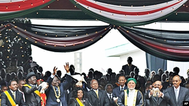 African leaders including indicted Sudanese President Omar al-Bashir joined tens of thousands of Kenyans when Kenyan President Mwai Kibaki to sign the new constitution into law, Nairobi, 27 Aug 2010