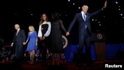 President Barack Obama (R) is joined onstage by first lady Michelle Obama and daughter Malia, Vice President Joe Biden and his wife Jill Biden, after his farewell address in Chicago, Illinois, Jan. 10, 2017.