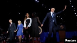 FILE - President Barack Obama (R) is joined onstage by first lady Michelle Obama and daughter Malia, Vice President Joe Biden and his wife Jill Biden, after his farewell address in Chicago, Illinois, Jan. 10, 2017.