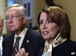House Democratic Leader Nancy Pelosi of Calif., right, speaks as Senate Minority Leader Harry Reid of Nev., left, listens as she talks to reporters on Capitol Hill in Washington, Wednesday, Oct. 28, 2015.