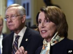 House Democratic Leader Nancy Pelosi of Calif., right, speaks as Senate Minority Leader Harry Reid of Nev., left, listens as she talks to reporters on Capitol Hill in Washington, Wednesday, Oct. 28, 2015.
